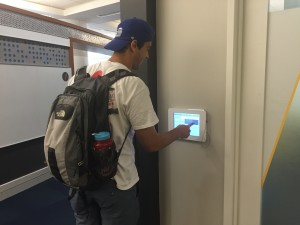 Student booking a study room using LibCal on mounted ipads